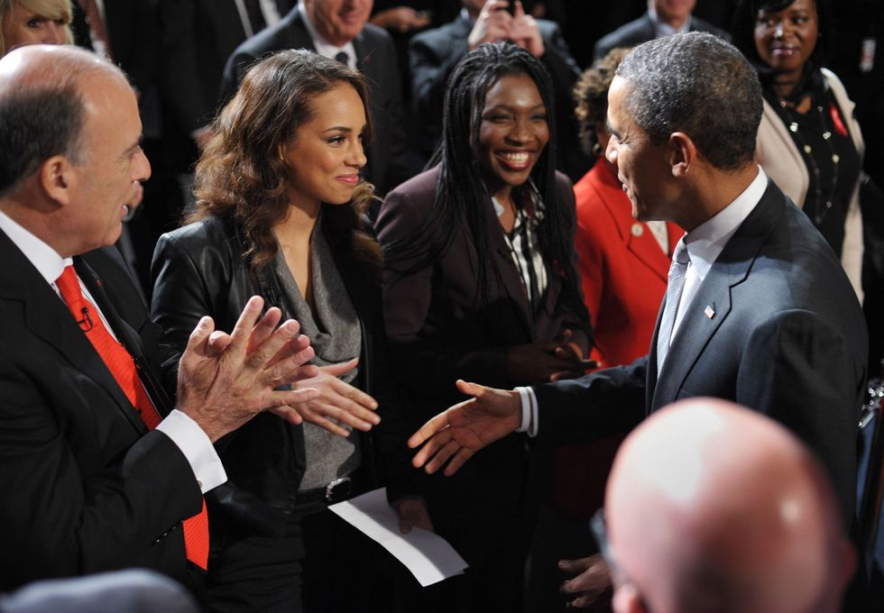 "Alicia Keys With Barack Obama The ""Girl on Fire"" reconnected with President Obama at a World AIDS Day event at George Washington University. The event, Hosted by ONE and (RED), was attended by politicians (including former presidents George W. Bush and Bill Clinton) and major entertainment influencers like Keys and U2 frontman Bono."