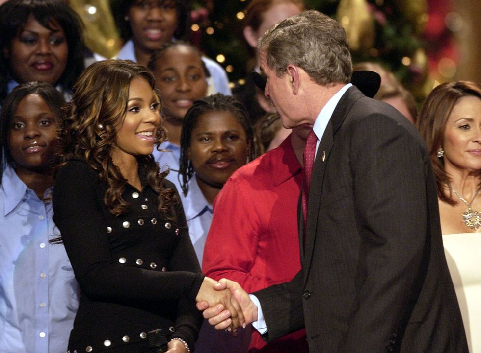 Ashanti With George W. Bush In 2003, R&B songstress Ashanti joined the president at the same holiday celebration clad in a chic black dress with button details.