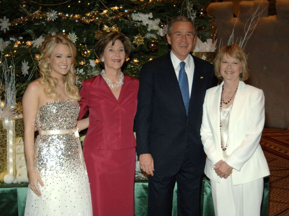 "Carrie Underwood With George W. Bush ""Christmas in Washington"" continued in 2005, and Carrie Underwood belted out various holiday staples onstage including ""Last Christmas"" and ""O Holy Night."" All eyes were on the American Idol winner as she glittered in a sparkled in a white ballgown, reminiscent of holiday tinsel."