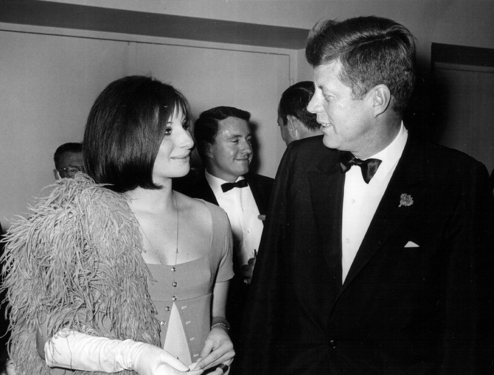Barbra Streisand With John F. Kennedy Barbra Streisand is obviously a mega star in her own right, but even this diva looked smitten with JFK when she met him in 1963. Her elbow-length white gloves and feathery boa are fancy and fun.