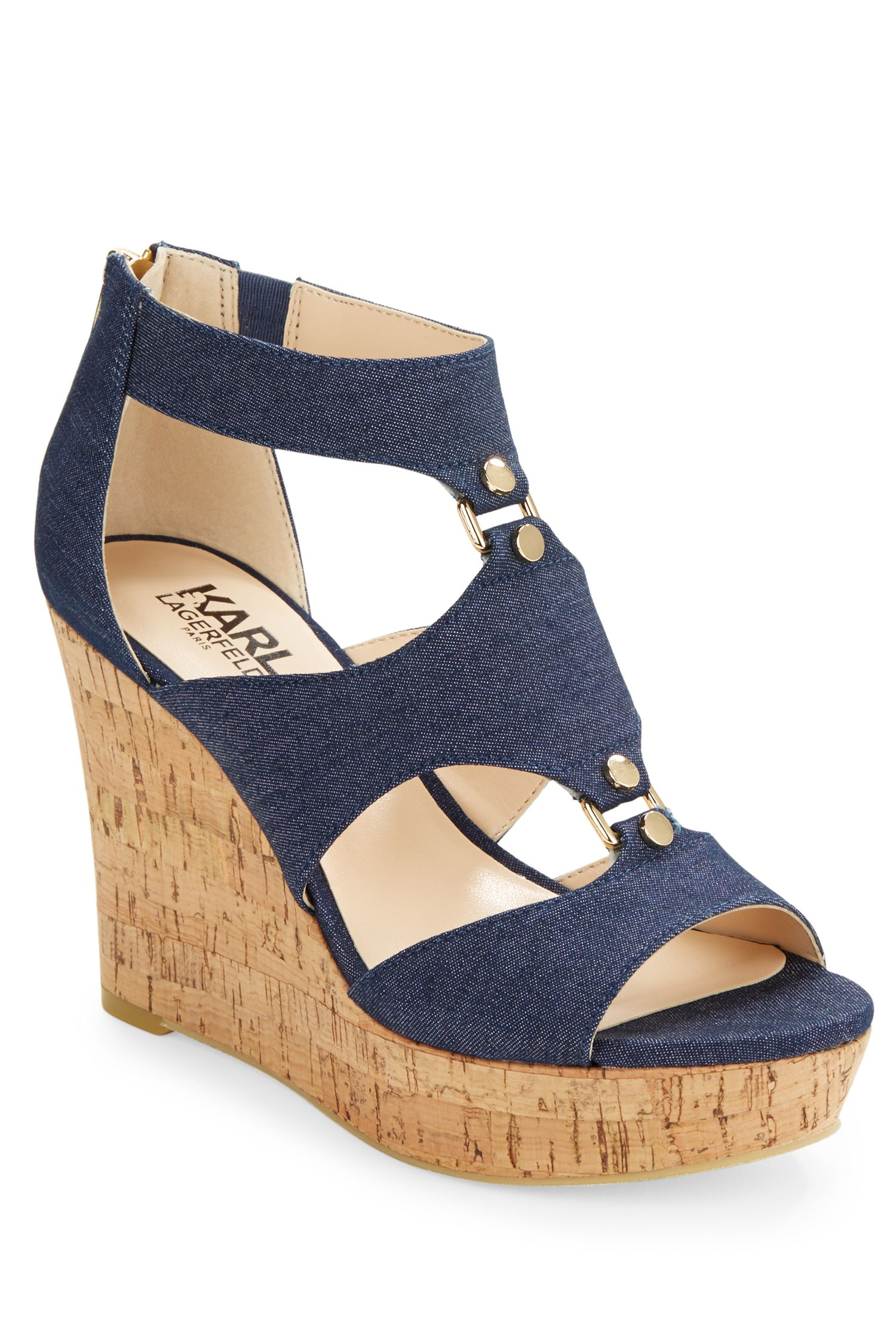 """<p>Neutral wedges make the whole denim shoe trend accessible for easy-breezy wear any day of the week (bonus if they're ultra-comfy). Reach for them with white pants, dresses, and even a pair of velvet shorts.</p><p><em>Karl Lagerfeld Savaoie Platform Wedge Sandals, $109&#x3B; </em><a href=""""http://www.lordandtaylor.com/webapp/wcs/stores/servlet/en/lord-and-taylor/savoie-platform-wedge-sandals"""" target=""""_blank""""><em>lordandtaylor.com</em></a></p>"""