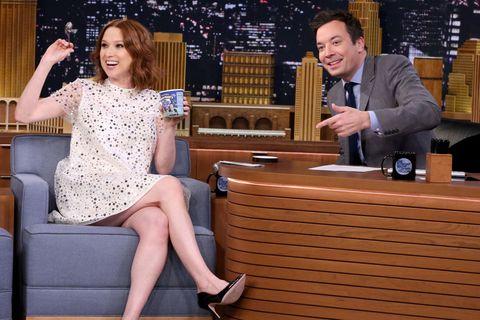 Dress, Human leg, Sitting, Thigh, Television program, Television presenter, Cocktail dress, Foot, Varnish, Ankle,