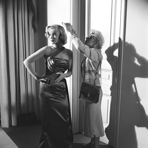 <p>On the set of <em>How To Marry A Millionaire</em> in 1953</p>