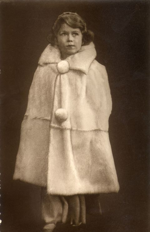 <p>Move over, superheroes and fashion editors — the Queen donned a chic cape as a little girl, long before these became popular.</p>