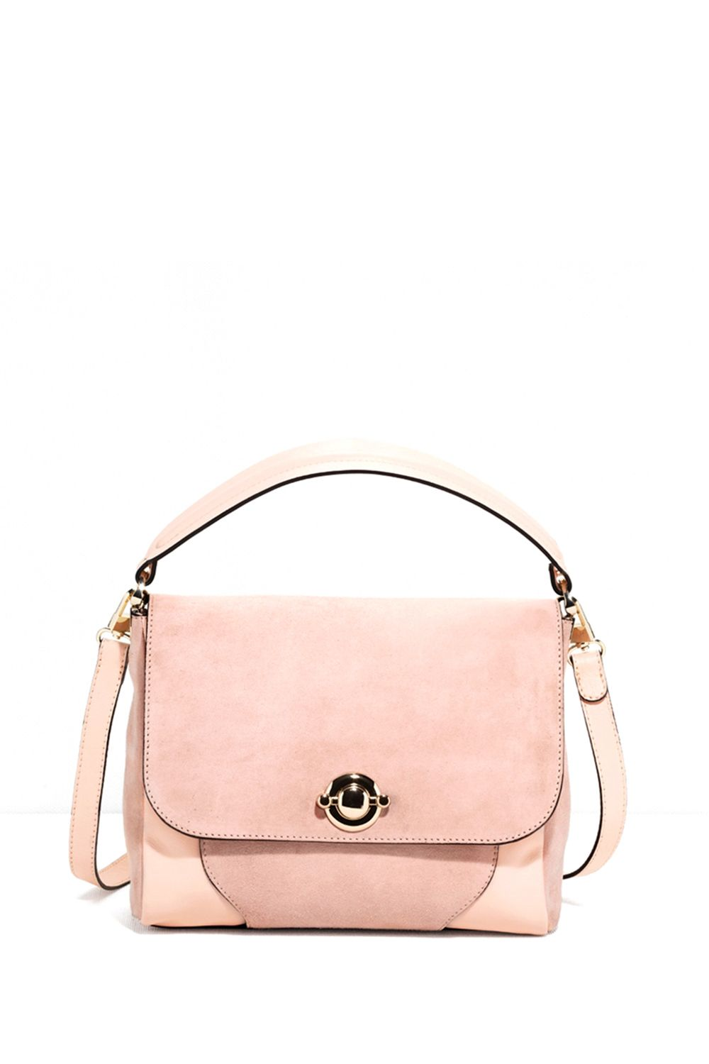 "<p>A pale pink lady bag that's perfect for work. </p><p><strong>Suede Shoulder Bag, $195; <a href=""http://www.stories.com/us/Bags/All_bags/Suede_Shoulder_Bag/590765-102954642.1"">stories.com</a>.</strong></p>"