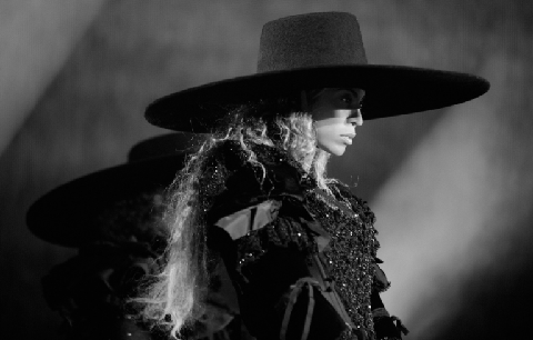 <p>To open the show, Bey was decked in a Victorian-inspired getup comprised of an oversized brim hat, black crystal embroidered bustier with puffy velvet shoulders, a tattoo lace body suit, and leather gloves.</p>