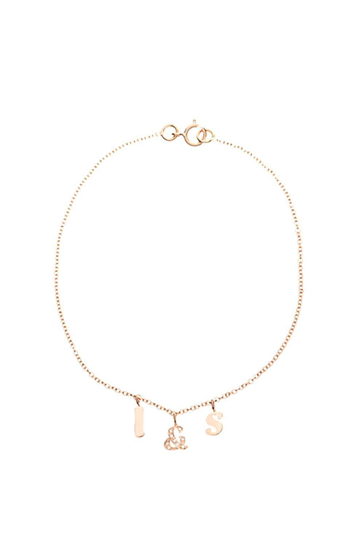 "<p>Ariel Gordon alphabet bracelet, $235, <a href=""http://rstyle.me/n/bpgut5bqb8f"" target=""_blank"">arielgordon.com</a>.</p>"