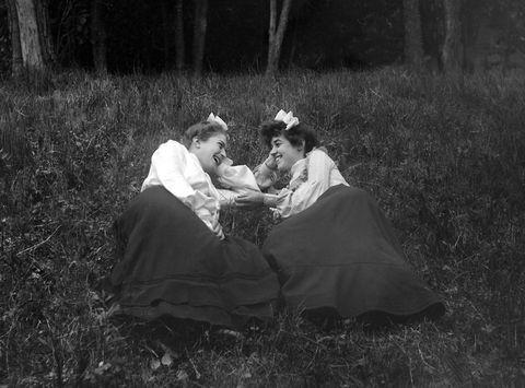 Photograph, Dress, Interaction, Monochrome, Sitting, Gown, Monochrome photography, Vintage clothing, Bride, Bridal clothing,
