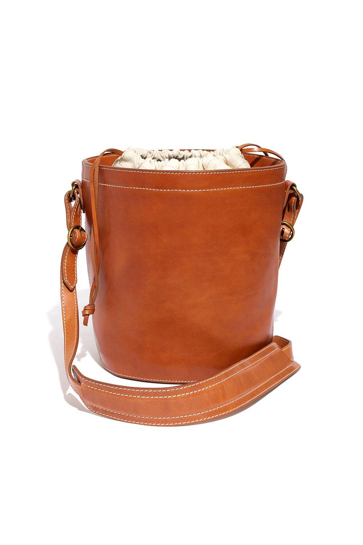 "<p>Rivet & Thread drawstring bucket bag, $268, <a href=""http://rstyle.me/n/bpe3bebqb8f"">madewell.com</a>.</p>"