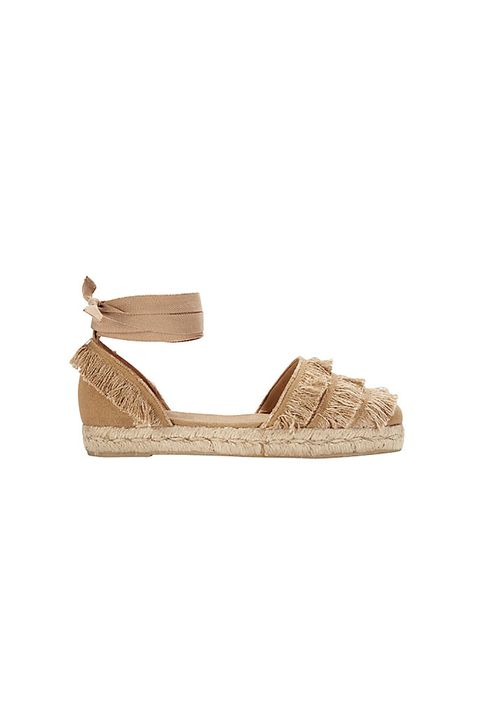 "<p>Castañer fringe espadrilles, $180, <a href=""http://kaanas.com/collections/women/products/new-nice-white"">intermix.com</a>.</p>"