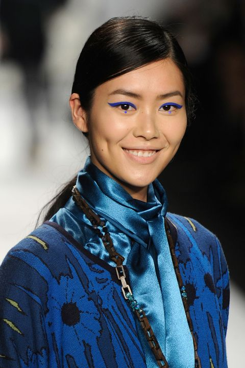 <p>If you're already going for a graphic color like cobalt blue, add a touch of whimsy by dropping a dot beneath each eye.</p>