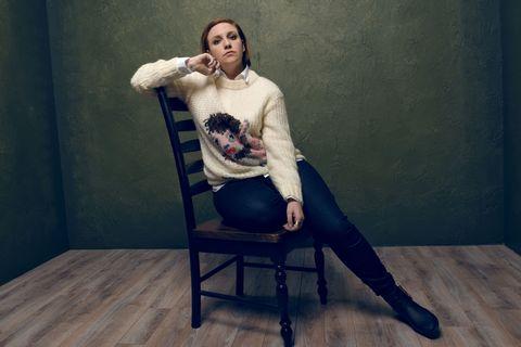 Sitting, Knee, Wood flooring, Laminate flooring, Sweater, Fashion model, Portrait,