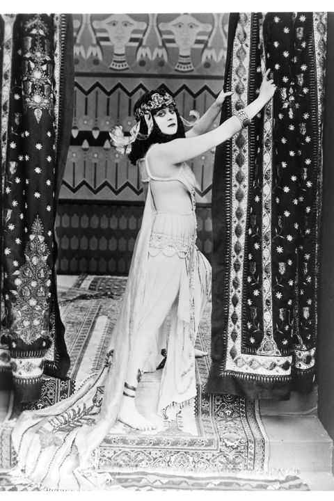 the actress theda bara—one of hollywood's first ever sex symbols and femme fatales—starred in the title role of the 1917 silent film cleopatra, wearing expensive and racy costumes that included a coiled snake bra that wrapped around her bare breasts