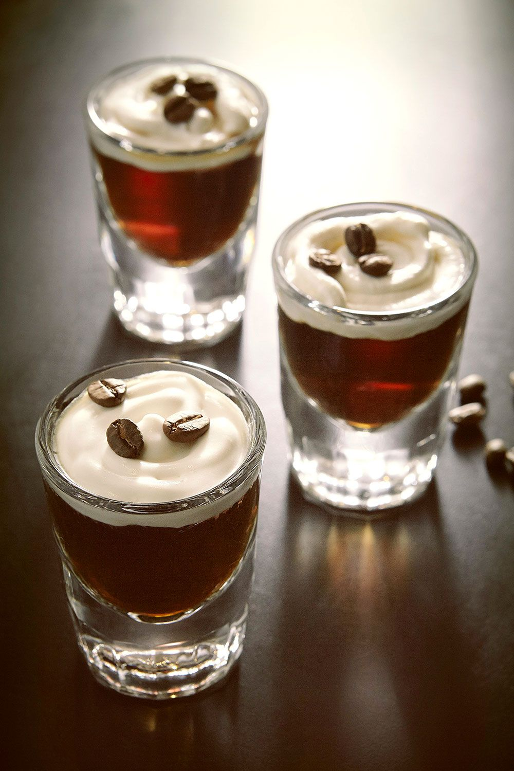 <p><strong>Ingredients:</strong></p><p>½ part Tullamore D.E.W. Original</p><p>¼ part premium coffee liqueur</p><p>¼ part thickened fresh cream</p><p>Coffee beans to garnish</p><p><strong>Directions:</strong></p><p>Add Tullamore D.E.W. and coffee liqueur to a mixing glass. Stir and pour into shot glasses. Top each with fresh cream and garnish with coffee beans.</p>