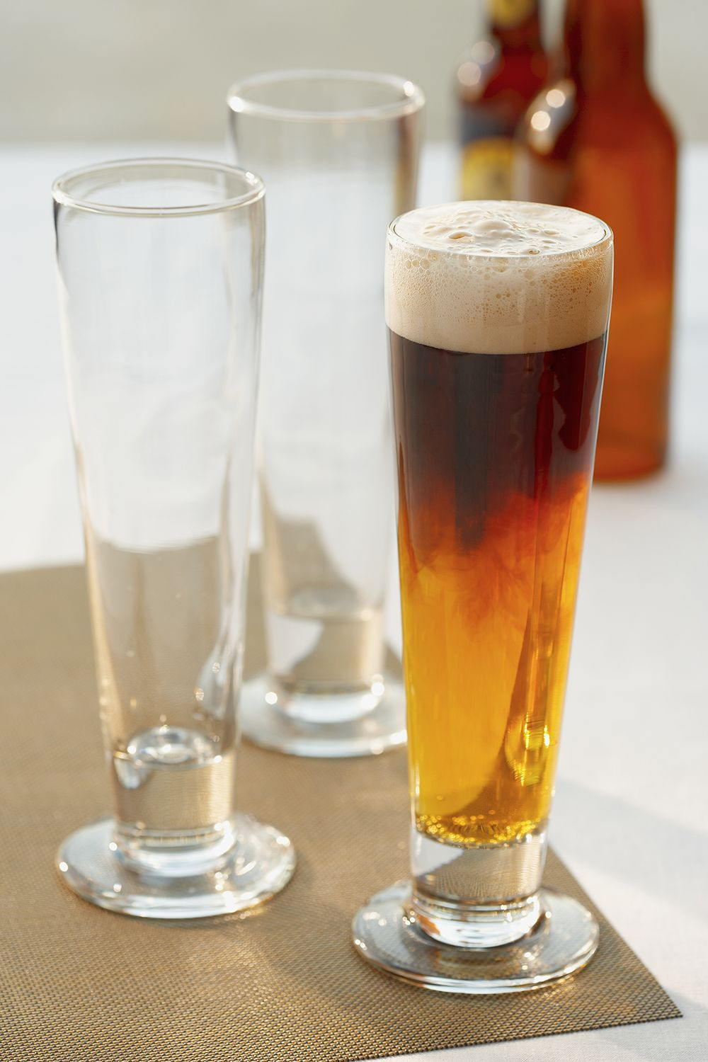 <p>What's better than one beer, if not two beers? The magic of the black and tan is pretty simple—layering a darker beer (usually a stout) and a lighter beer (usually a pale ale) one on top of the other. But the effect? Delicioso. </p>