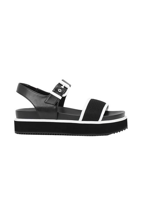 "<p>The '90s called. They said ""Keep our aesthetic, because you're clearly doing it better."" </p><p>$39, <a href=""http://www.charleskeith.com/us/lug-sole-flatform-sandals-black-ck1-70380490.html"">charleskeith.com</a>.</p>"