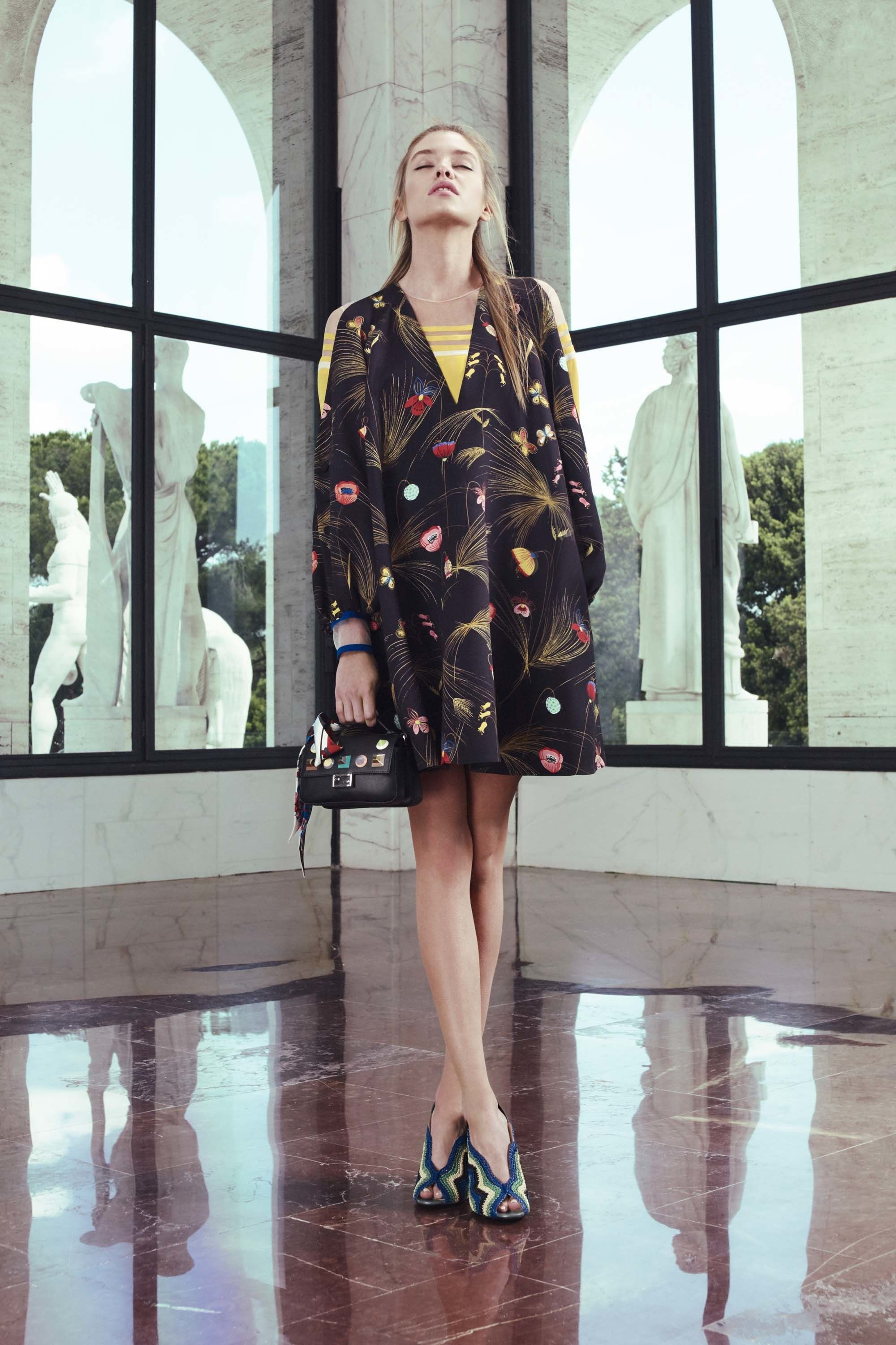 <p>Uncle Karl, back at it again (this time at Fendi) with a yellow racing-stripe number paired with a split-shoulder dress. </p>