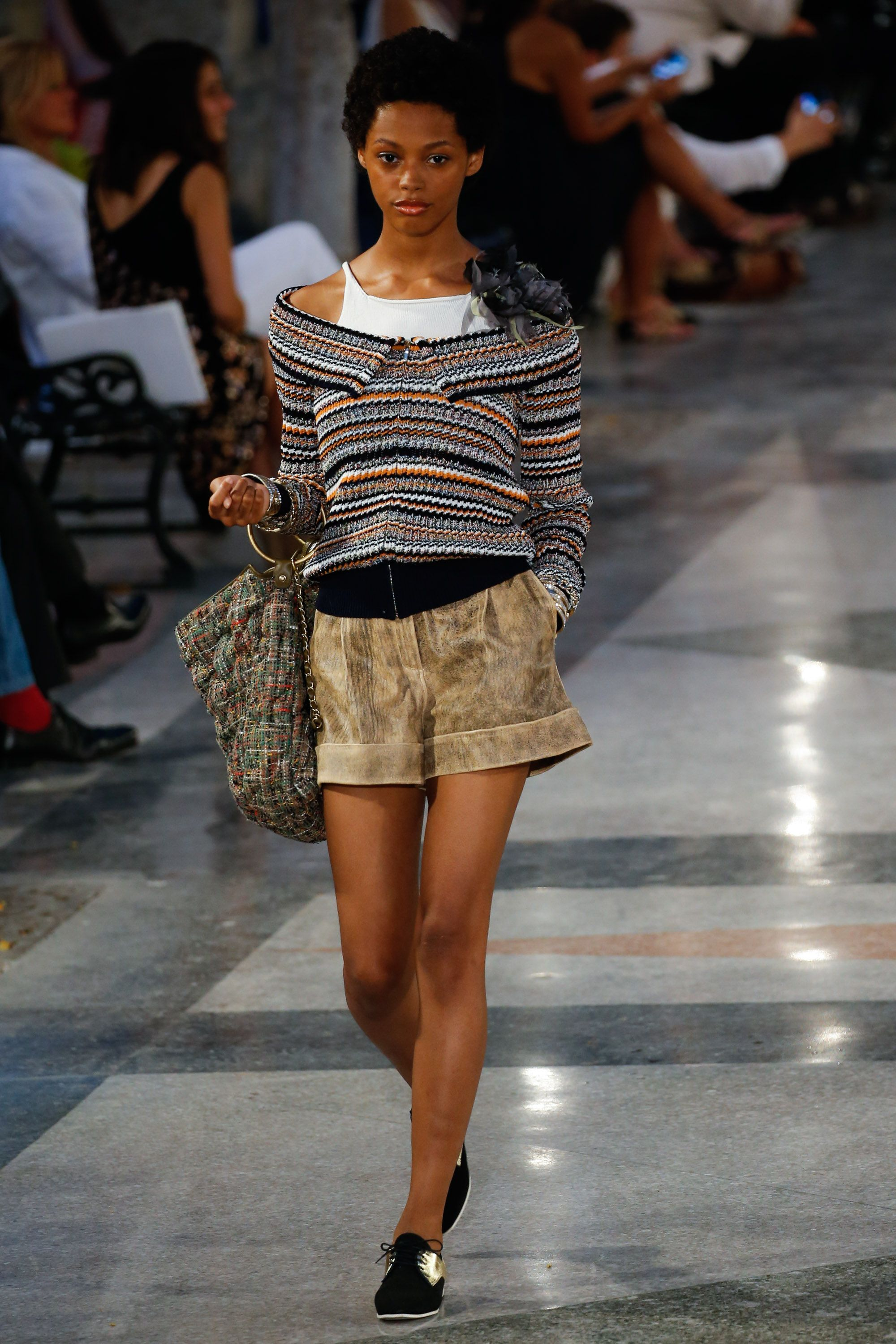 <p>We're past the off-the-shoulder-top saturation point, but here comes Chanel with a solution that simultaneously takes care of your teenybopper halter-tank obsession. </p>