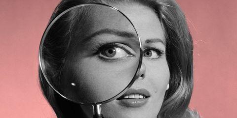 Lip, Black hair, Eyelash, Magnifier, Audio accessory, Portrait, Magnifying glass, Portrait photography, Hearing,