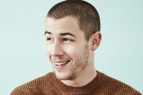Ear, Lip, Cheek, Smile, Facial hair, Hairstyle, Sweater, Skin, Chin, Forehead,