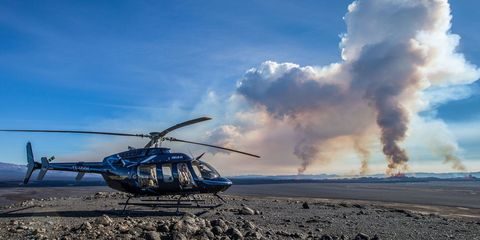 Helicopter, Rotorcraft, Mode of transport, Aircraft, Sky, Cloud, Helicopter rotor, Aviation, Air travel, Smoke,