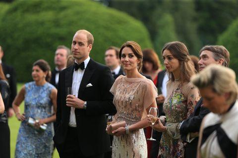 People, Dress, Trousers, Coat, Formal wear, Suit, Ceremony, Blazer, Necklace, One-piece garment,