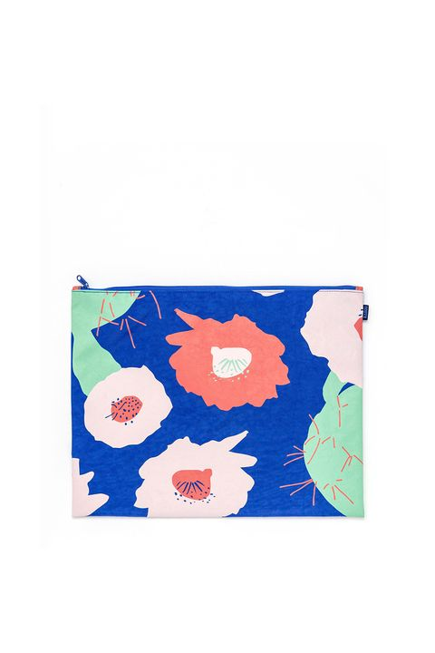 "<p>Since it's slightly larger than average, use this printed pouch to tote items like notebooks and toiletries on-the-go. Or, carry it sandwich style as a fold-over clutch with a summery dress.</p><p><strong>Baggu Large Flat Zip, $15; <a href=""http://baggu.com/collections/clutches-pouches/products/large-flat-zip-cobalt-cactus-flower?variant=13869529543"">baggu.com</a>.</strong></p>"