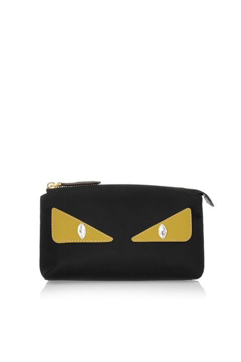 "<p>This cute-as-a-button Fendi monster pouch doubles as a *fashion* clutch when you want to go hands-free at an after-hours event.</p><p><strong>Fendi Monster Eyes Shell Cosmetic Case, $250; <a href=""https://www.net-a-porter.com/us/en/product/639288/Fendi/monster-eyes-embellished-leather-trimmed-shell-cosmetics-case"">netaporter.com</a>.</strong></p>"