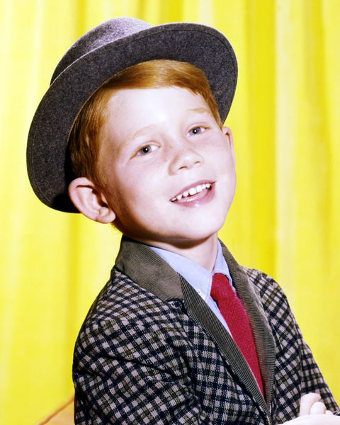 """<p>Another <em>Happy Days</em> alum, Ron Howard first got his start as <a target=""""_blank"""" href=""""http://www.goodhousekeeping.com/beauty/hair/g2441/red-hair-color-ideas/"""">adorable redhead</a> Opie Taylor on <em>The Andy Griffith Show</em> before moving onto his role as Richie Cunningham.</p>"""