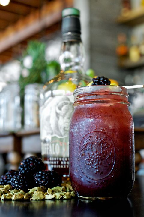 <p>Mason jar drinks are the best kind of summer drinks. </p><p><strong>Ingredients: </strong></p><p>1.5 oz. Bourbon</p><p>3/4 oz. Fresh Lemon Juice</p><p>3/4 oz. Simple Syrup</p><p>1/2 oz. Blackberry Puree</p><p>1 Cardamom Pod</p><p>Sparkling Wine</p><p>Lemon Wheel and Fresh Blackberry, for garnish</p><p><strong>Directions: </strong></p><p>Muddle the cardamom in a mixing glass, then add bourbon, lemon juice, simple syrup and blackberry puree. Add ice, and shake until well-chilled.  Strain into a collins glass or mason jar filled with ice, and top with a dry sparkling wine. Garnish with a lemon wheel and a fresh blackberry.<br></p>
