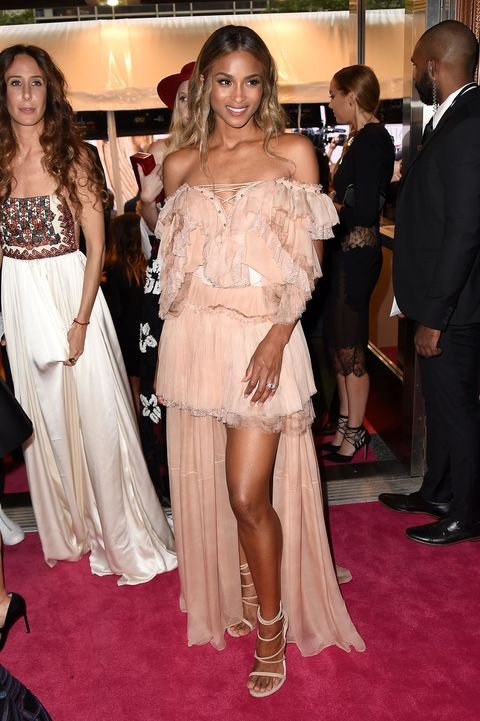 <p>Both Ciara and designer Peter Dundas are fans of the low-cut, lace-up neckline. Seriously—it's practically their signature. </p>