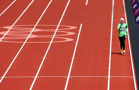 Sport venue, Track and field athletics, Red, Line, Athletic shoe, Flag, Playing sports, Sports, Jersey, Race track,