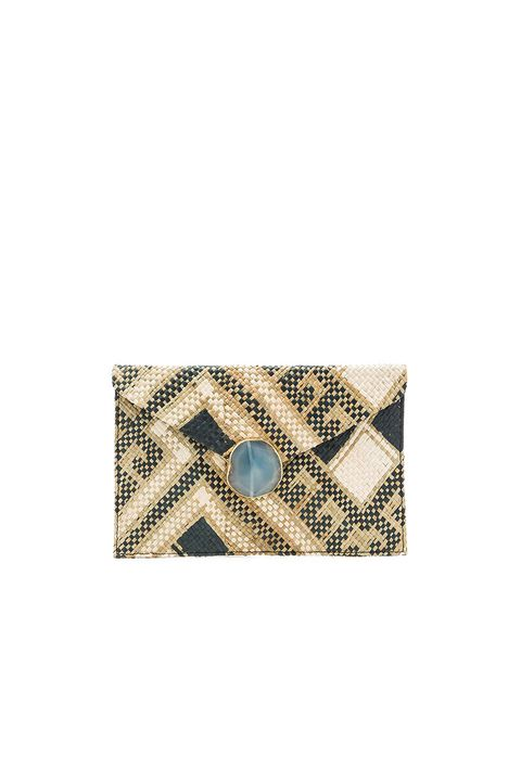 "<p>This summery woven handbag features a dramatic agate clasp—and can be worn both as a clutch or as a shoulder bag with an attached delicate gold chain. Which means hands-free stylish storage for your keys, phone and lipstick as you sip on that summer spritz.<span></span></p><p><em>      Kayu Saguaro clutch, $184, <a href=""http://www.revolve.com/kayu-saguaro-clutch-in- black/dp/KAYR-WY10/?d=F"" target=""_blank"">revolve.com</a></em></p>"
