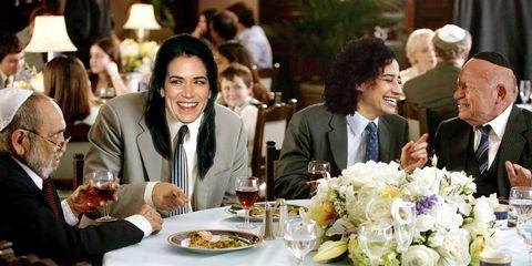 Smile, Stemware, Drink, Drinkware, Wine glass, Tableware, Bouquet, Formal wear, Facial expression, Suit,