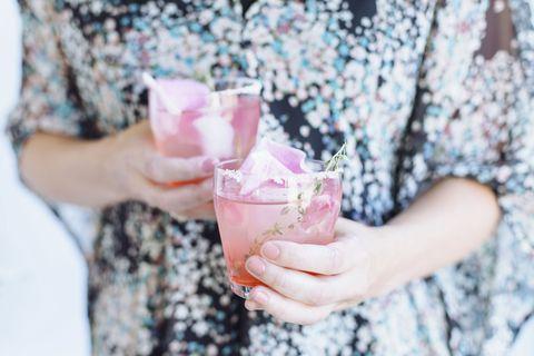 Fluid, Hand, Liquid, Pink, Ingredient, Drink, Drinkware, Drinking straw, Recipe, Ice cube,