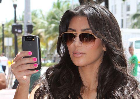 Eyewear, Vision care, Glasses, Finger, Hairstyle, Mobile phone, Sunglasses, Telephony, Portable communications device, Communication Device,
