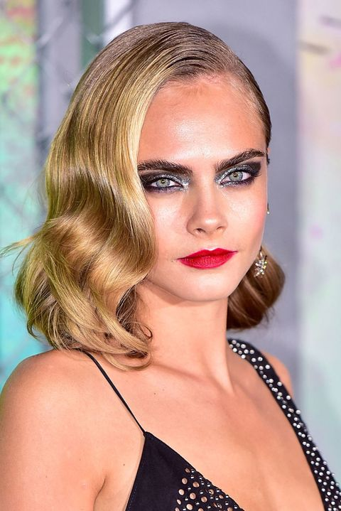<p>Channel Cara Delevingne's badass look at the <em>Suicide Squad</em> premiere by layering the metallic foil pigment on thick with smoky black liner on the waterlines. </p>