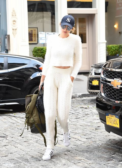 "<p>Here, she's in <a href=""http://www.marieclaire.com/fashion/news/g3866/taylor-swift-weekend-fashion-credits/"" target=""_blank"">the same Majorelle knit</a> she wore to Taylor Swift's July 4 extravaganza but paired with tracksuit bottoms in sweater fabric?? Good thing it's backless—the top, not the pants.</p>"