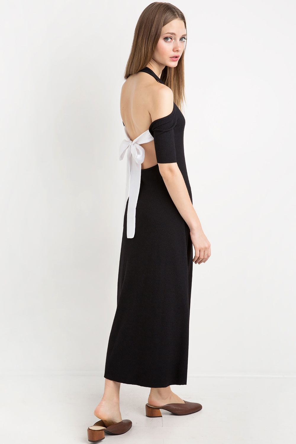 "<p>When you love a <a href=""http://www.marieclaire.com/fashion/news/g3650/spring-tops-earrings/"" target=""_blank"">tie-back bodysuit</a> so much you buy the dress version of it. (The <a href=""http://www.marieclaire.com/fashion/news/g3650/spring-tops-earrings/"" target=""_blank"">earring pairing</a> still stands.) </p><p>$112, <a href=""http://www.pixiemarket.com/sunday-tie-back-midi-dress-by-new-revival.html"" target=""_blank"">pixiemarket.com</a>.</p>"