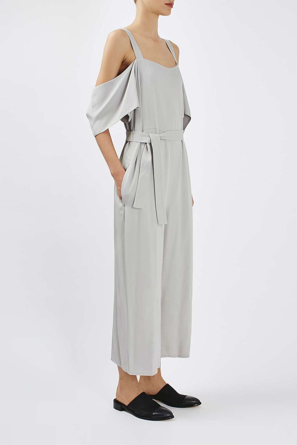 """<p>For those artsy casual-cool offices where anything goes. Or, layered with a sweater for more conservative spaces. </p><p><strong>Off-the-Shoulder Jumpsuit by Boutique, $150; <a href=""""http://us.topshop.com/en/tsus/product/clothing-70483/rompers-jumpsuits-4107634/off-the-shoulder-jumpsuit-by-boutique-5740558?bi=20&ps=20"""" target=""""_blank"""">topshop.com</a>. </strong></p>"""