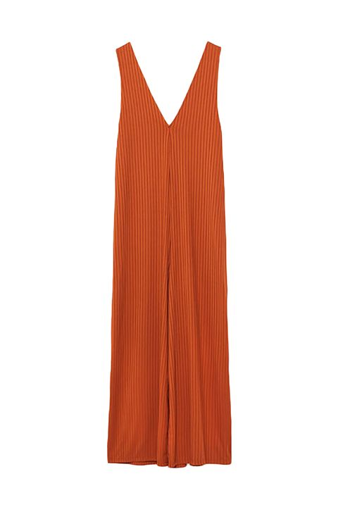 "<p>A classic v-neck jumpsuit that easily transitions from breezy summer attire to rock-with-a-turtleneck fall bliss. </p><p><strong></strong></p><p><strong>Strappy Jumpsuit, $26; <a href=""http://www.zara.com/us/en/trf/new-in/strappy-jumpsuit-c840006p3929008.html"" target=""_blank"">zara.com</a>. </strong></p>"
