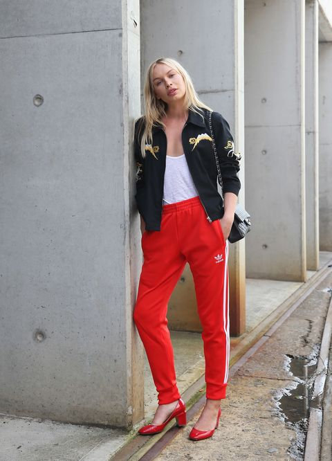 <p>Literally just make a whole different tracksuit using tracksuit parts from your friendly neighborhood tracksuit supplier, AKA your closet. Take the jacket from one, the bottoms from another, and glue it all together with a white tank, a wall-lean, and some classic uptown-girl accessories like the Valentino pumps. </p>