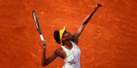 Finger, Skin, Elbow, Hand, Tennis racket, Sports equipment, Wrist, Racketlon, Tennis player, Soft tennis,
