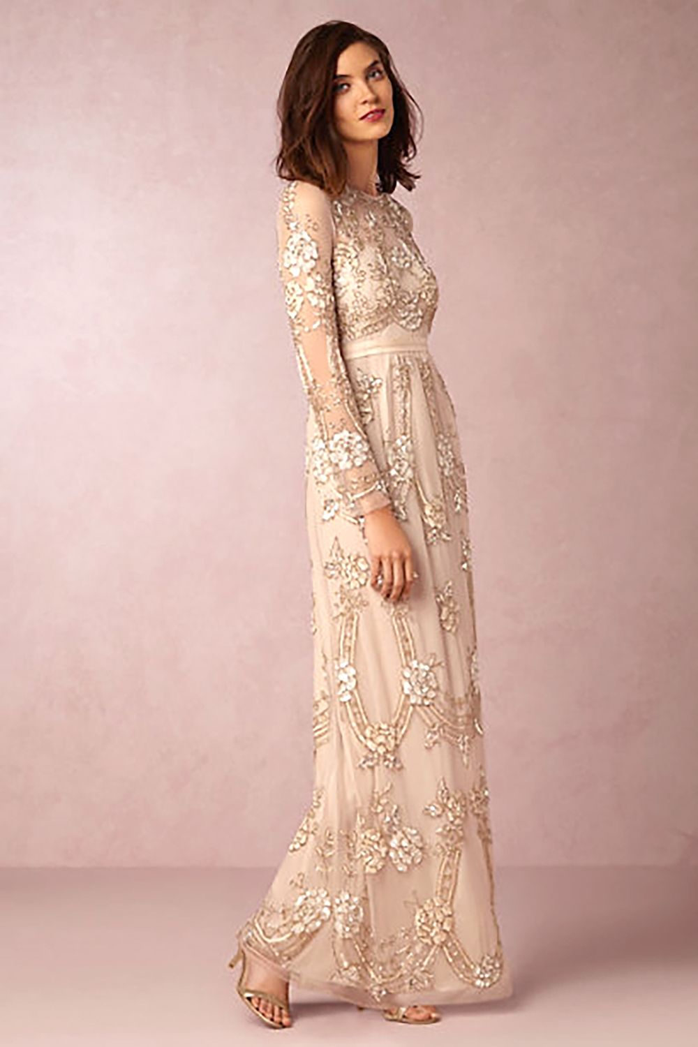 """<p>This vintage-inspired number is rose-hued and *gorgeous* on, with its high neck and bead work.</p><p>Adona Dress, $570; <a href=""""http://www.bhldn.com/shop-the-bride-wedding-dresses/adona-dress/productOptionIDS/fbcaeb8b-b90b-4e9a-9313-32da085940dd """" target=""""_blank"""">bhldn.com</a></p>"""