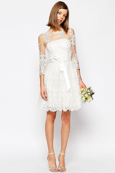 "<p>This short, lacy number is absolutely perfect for a garden venue or a jaunt to city hall.&nbsp;</p><p>Long Sleeve Lace Mini Dress, $258; <a href=""http://www.asos.com/asos/asos-bridal-long-sleeve-lace-mini-dress/prod/pgeproduct.aspx?iid=5997832 "" target=""_blank"">asos.com</a></p>"