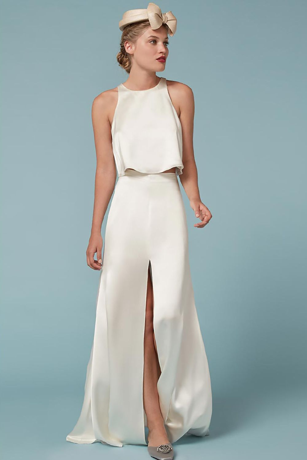 """<p>This two-piece creates the ultimate modern-meets-vintage vibe, and can be split up for future wear.</p><p>Gemini Two Piece, $588; <a href=""""https://www.thereformation.com/products/gemini-two-piece-ivory """" target=""""_blank"""">thereformation.com</a></p>"""