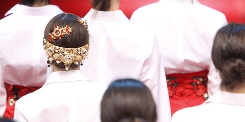Hairstyle, Headgear, Tradition, Fashion accessory, Costume accessory, Fashion, Temple, Ceremony, Headpiece, Hair accessory,