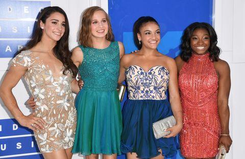 Blue, Smile, Shoulder, Dress, Textile, Joint, Waist, Happy, Community, One-piece garment,