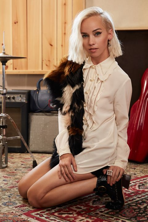 "<p>""This beautiful white collared shirt with pearl buttons is versatile&nbsp;and could work with any style,"" Margot says. ""It's great to keep things simple, but have one flashy accessory."" That epic fur shawl is the perfect accessory, yes? </p><p><em data-redactor-tag=""em"">Coach 1941 Shirt with Ruffle, $450, <a rel=""noskim"" href=""http://www.coach.com/coach-designer-tops-shirt-with-ruffle-/56450.html?CID=D_B_MRC_11504"" target=""_blank"" data-saferedirecturl=""https://www.google.com/url?hl=en&amp;q=http://www.coach.com/coach-designer-tops-shirt-with-ruffle-/56450.html?dwvar_color%3DIVO%26dwvar_size%3D10&amp;source=gmail&amp;ust=1472912485399000&amp;usg=AFQjCNFu-5mNfcV_BwvaWgho10mbWePGrg"">coach.com</a>; Coach 1941 Chelsea Boot $575, <a rel=""noskim"" href=""http://www.coach.com/coach-designer-booties-chelsea-boot/Q8919.html?CID=D_B_MRC_11505"" target=""_blank"" data-saferedirecturl=""https://www.google.com/url?hl=en&amp;q=http://www.coach.com/coach-designer-booties-chelsea-boot/Q8919.html?dwvar_size%3D11%2520%2520B%26dwvar_color%3DBLK&amp;source=gmail&amp;ust=1472912485399000&amp;usg=AFQjCNFD7eK4KlYwxBbjkclJoklYvw1RXA"">coach.com</a>; Coach 1941 B-Boy Shearling Shawl, $795, <a rel=""noskim"" href=""http://www.coach.com/coach-designer-scarves-b-boy-prairie-shearling-shawl/56255.html?CID=D_B_MRC_11506"" target=""_blank"" data-saferedirecturl=""https://www.google.com/url?hl=en&amp;q=http://www.coach.com/coach-designer-scarves-b-boy-prairie-shearling-shawl/56255.html?dwvar_color%3DBLC%26dwvar_size%3DONE&amp;source=gmail&amp;ust=1472912485399000&amp;usg=AFQjCNHTT_MpK3duX_w40sSdjtyDVTGHMA"">coach.com</a></em></p>"
