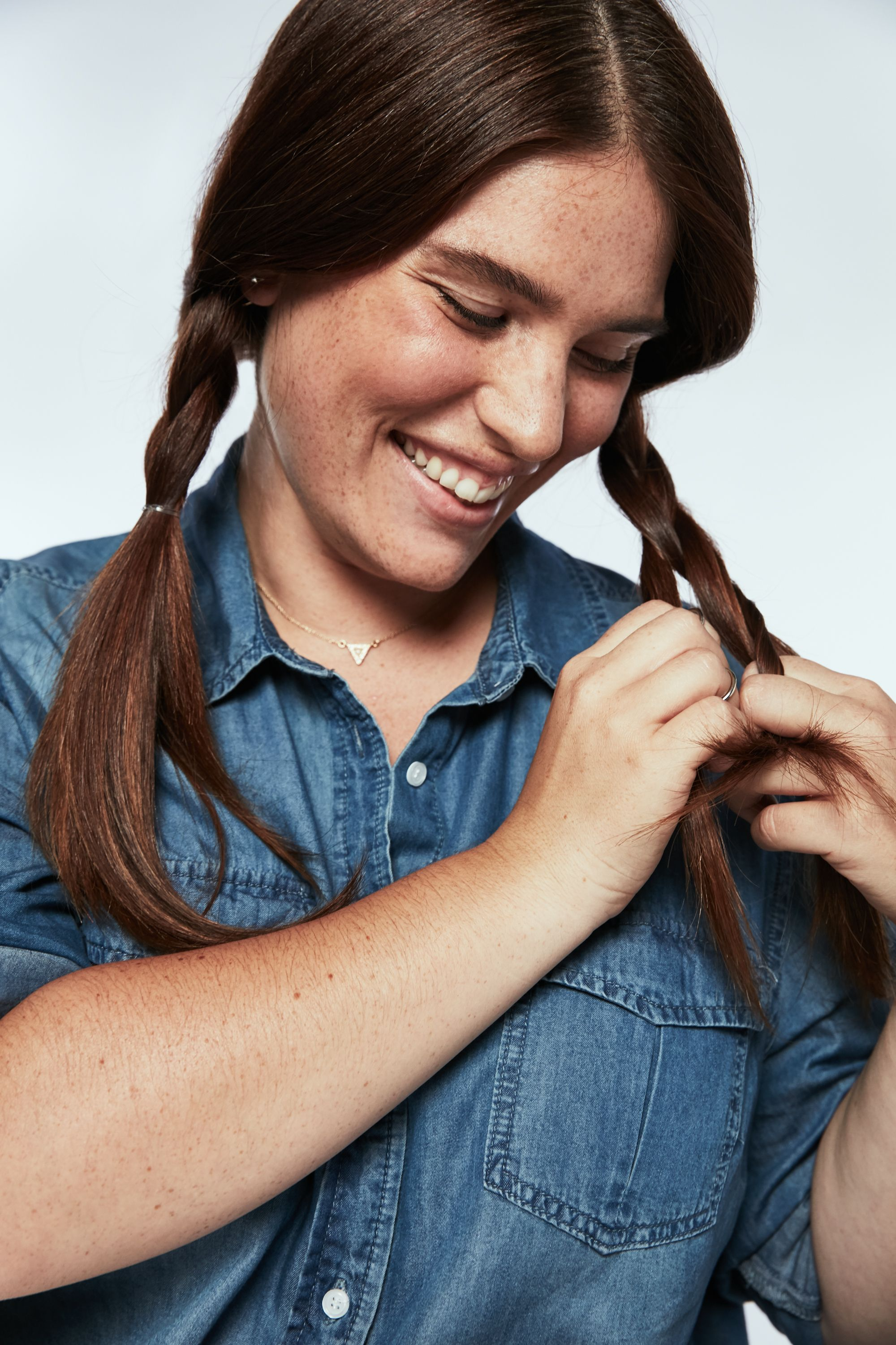 "<p>Repeat the step one on the other side. The key to pulling off the adult version of pigtails: ""These braids should be a little baggy,"" Buckett says. ""Your hair should almost cover your ears.""</p>"